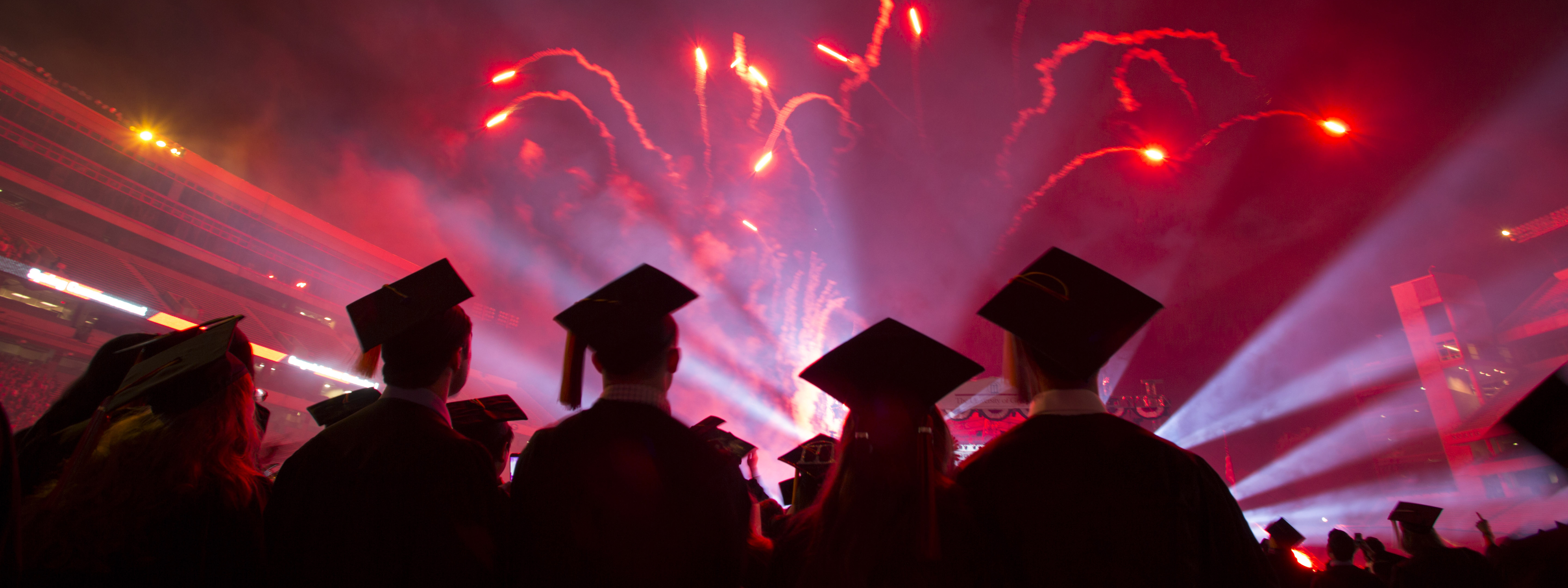 Students celebrate graduation with fireworks at Commencement.